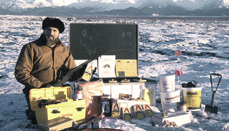 Steve Ebbert, a wildlife biologist for the Alaska Maritime National Wildlife Refuge, posies with the rat response kit on one of Alaska's Aleutian Islands.  Alaska is joining forces with federal wildlife biologists in a multi-pronged attack to drive the rats from the islands.