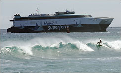 The Hawaii Superferry approaches Aloha Towers in Honolulu in June.
