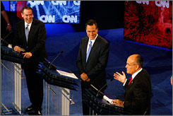 GOP candidates, from left, Mike Huckabee, Mitt Romney and Rudy Giuliani discussed illegal immigration Wednesday.