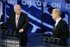 Sen. John McCain, R-Ariz., left, and Rep. Ron Paul, R-Texas, right, had a heated exchange over the Iraq war in Wednesday night's debate at the Mahaffey Theater in St. Petersburg, Fla.