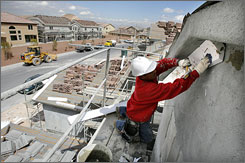 Workmen are shown at a construction site in Las Vegas. Nevada finished second among U.S. states in percentage of residents who moved in to the state in 2006.