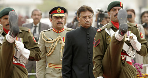 Musharraf reviews guard of honor after his swearing in as civilian president on Thursday.