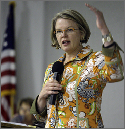 Education Secretary Margaret Spellings, seen here visiting an elementary school in Anchorage, Alaska in August,  has urged colleges and universities  to end potential conflicts of interest with lenders and legislation moving through Congress would prohibit college officials from serving on boards of lenders that do business at those schools.