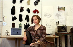 Jennifer Gooch, a graduate student in the Carnegie Mellon University School of Art, poses for a portrait in her studio in Pittsburgh, Pa, on Friday. Gooch started www.onecoldhand.com in an effort to reunite dropped gloves with their mates.