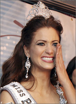 Miss Puerto Rico Universe 2007 winner Ingrid Marie Rivera reacts with tears during the post-contest news conference at the Center of Performing Arts in San Juan on Nov. 23. Someone doused her make-up and clothes with pepper spray, but Rivera put on a happy face and managed to win the pageant.
