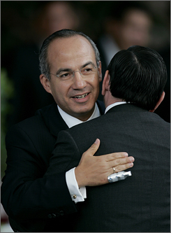 Mexico's President Felipe Calderon attends a ceremony commemorating his first year in office at the National Palace in Mexico City on Saturday.