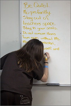 At the Pre-Trial Detention Center, in Jacksonville, Fla., inmates have to write the classroom rules for all to see during an integrated subjects middle and high school class.