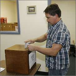 Larry Faith of Glasgow, Ky., bids on some of the 62 boxes of wild ginseng roots confiscated from poachers.