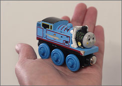 Thomas The Tank Engine toy train may contain lead or have small, removable parts that can be swallowed by children. Toy-drive organizers are coping with the fallout from the recall of millions of Chinese-made toys.