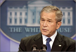 President Bush speaks during a news conference Tuesday in the Brady Press Room at the White House in Washington.
