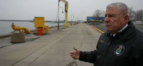 Waukegan, Ill., Mayor Richard Hyde stands along an industrial harbor on the Lake Michigan lakefront. Hyde hopes to replace the industry along the lake with recreation area and residences.