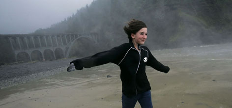 Samantha Johnson, 16, braces against hurricane-force wind gusts on the beach at Devil's Elbow State Park near the Heceta Head Lighthouse north of Florence, Ore.
