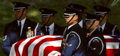 U.S. Air Force honor guards carry the casket of Airman First Class Leebernard Chavis at Arlington National Cemetery in Arlington, Va., last October. At the time more troops had been killed in Iraq than in any other month of the year.