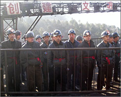 Rescuers prepare to search for victims at a coal mine where a gas blast killed at least 70 and left scores trapped underground in Hongtong county, Shanxi province, Thursday.