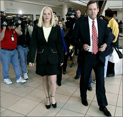 Former middle school teacher Debra Lafave leaves court with her attorney in Nov. 2005, after pleading guilty to having sex with a 14-year-old student.