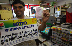 Rushi Patel of Ocean Breeze Liquor and Pub in Jensen Beach, Fla., says his store sold one of two winning lottery tickets for a $6 million jackpot. It has yet to be turned in and will expire on Dec. 24.