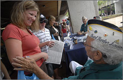 """Every day they show up, it's like a gift"": Donna Corrigan and son Alex, 13, chat with Pearl Harbor survivor Alfred Rodrigues, 87."