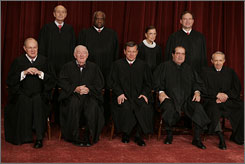 The justices are seen in this 2006 file photo (l-r, front row, Anthony M. Kennedy, John Paul Stevens, Chief Justice John G. Roberts, Antonin Scalia and David Souter; second row, Stephen G. Breyer, Clarence Thomas, Ruth Bader Ginsburg and Samuel Alito).
