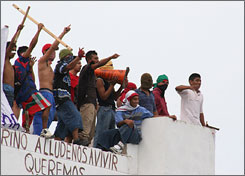 Inmates protest on the roof of the state penetentiary in Cancun, Mexico, last December.