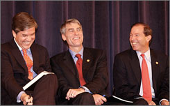 Udall family cousins from left, Sen. Gordon Smith, R-Ore., and Reps. Mark Udall, D-Colo., and Tom Udall, D-N.M., share a laugh in Washington.
