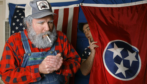 """Actors Travis Harmon, left, and Jonathan Shockley, pose in character on the set used to tape their web show """"Travis And Jonathan: Red State Update,"""" at Harmon's home in Los Angeles."""