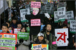 South Korean anti-war demonstrators staged a protest Nov. 18 demanding the withdrawal of South Korean troops from Iraq and Afghanistan. The country plans to end its military presence in Afghanistan this week.