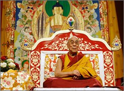 "The Dalai Lama is seen at the beginning of a three-day teaching event called ""The way toward Inner Peace"" in Milan, Italy, Friday."