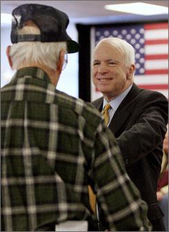 Republican presidential hopeful Sen. John McCain, R-Ariz., takes a question from veteran David Hamblett during a campaign stop in Nashua, N.H., on Dec. 8.