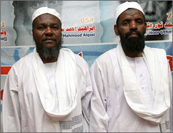 Former Guantanamo detainees Adel Hassan Hamad, left, and Salim Mahmoud Adam arrive in Khartoum on Thursday.