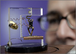 Dag Spicer, senior curator of the Computer History Museum, in Mountain View, Calif., looks at a replica of the first transistor.