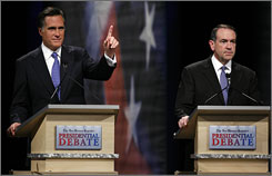 Republican presidential hopefuls Mitt Romney, left,  and Arkansas Gov. Mike Huckabee looks, seen here at the the Des Moines Register Republican Presidential Debate in Johnston, Iowa  on Dec.12,  talk the most like President Bush on ethanol.