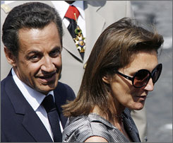 French president Nicolas Sarkozy and his former wife Cecilia are shown here attending a Bastille Day ceremony in July. Sarkozy reportedly is now dating supermodel-turned-singer Carla Bruni.