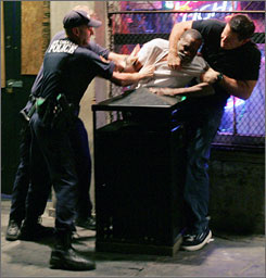 Police officers subdue a man later identified as Robert Davis in the French Quarter of New Orleans on Oct. 8, 2005. A former police officer accused in the videotaped beating was acquitted last July by a judge who heard the case without a jury.