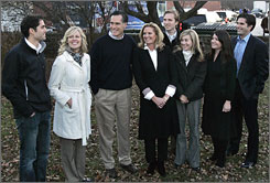 Mitt Romney gathers with family members for a photograph as they campaign in Newport, N.H.