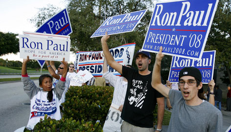 Vocal supporters of Rep. Ron Paul, R-Texas, wave banners before the start of the Univision Republican debate at the University of Miami in Coral Gables, Fla., on Dec. 9.