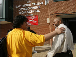 Robinson talks to ninth grader Daniel Tanner, 15, at the end of the school day at Baltimore Talent Development High School.