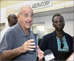Pathologist Cyril Wecht, left, the former coroner for Allegheny County, Pa., is facing theft and fraud charges for allegedly using county resources for his own benefit.