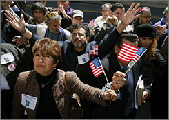"Wearing plastic handcuffs and waving U.S. flags, youth pastor Magdalena Schwartz of Mesa, Ariz., left, prayed with others outside a Senate office building  to protest measures criminalizing clergy who aid undocumented immigrants in March '06. Illegal immigrants are leaving Arizona because ""they don't want to live in fear,"" Schwartz said."