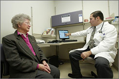 "Dr. Stephen Lewis,  demonstrates how doctors use exam room computers and consult with patients like Ruth Rinehimer, 81. Lewis, of Geisinger Medical Group Berwick in Berwick, Pa., is one of 5,000 doctors participating in Medicare's ""pay for performance"" pilot project."