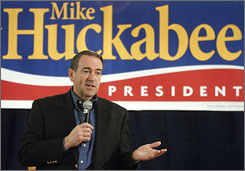 Republican presidential hopeful Mike Huckabee, speaks to supporters during a campaign stop in Council Bluffs, Iowa.