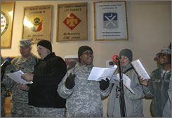 U.S. soldiers sing Christmas carols at Phoenix military camp, in Kabul, Afghanistan, Sunday. As Christmas approaches, overseas military bases try to bring a bit of the holiday to soldiers far from home.