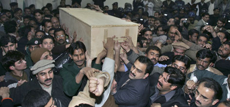 People carry the coffin of Pakistan's former Prime Minister Benazir Bhutto at a local hospital in Rawalpindi, Pakistan. Bhutto was assassinated in a suicide attack earlier Thursday.