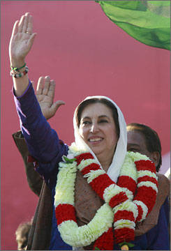 Pakistan's former Prime Minister and opposition leader Benazir Bhutto waves during an election rally in Rawalpindi, Thursday, shortly before she was killed in a gun and bomb attack.