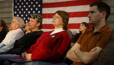 Iowa voters, like these at a Barack Obama town hall meeting Friday in Williamsburg, Iowa, are hearing candidates make their last push for votes before the Iowa caucuses on Jan. 3.