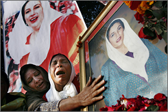 Women weep over a portrait of former Pakistani prime minister Benazir Bhutto at her house Sunday in Lahore.