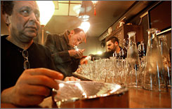 Patrons smoke Sunday in a bar in Valenciennes, northern France. The country joins many of its neighbors on New Year's Day in imposing a tobacco ban in bars, restaurants and nightclubs.