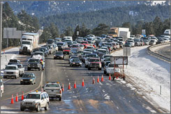 More than 2,000 travelers were stranded at Red Cross shelters in the Colorado high country, Monday, as a threat of avalanches closed a stretch of Interstate 70 west of Denver, shown here.