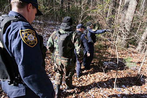 Members of the Gwinnett County Sheriff's Rapid Response Team aid in the search at Blood Mountain at Vogel State Park, Friday, in Blairsville, Ga.