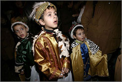 Children dressed up as the Three Wise Men led by the Christmas star attend the traditional Epiphany parade in Malaga, Spain, on Saturday. Kids in Spain receive their Christmas presents on the morning of the Epiphany, Jan. 6, delivered by the Magi, not Santa.