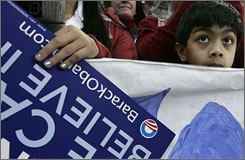 A young boy listens as Sen. Barack Obama, D-Ill., speaks at a rally Sunday, Jan. 6, in Derry, N.H.